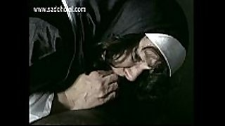 Beautiful nun slave bends over with her panties...