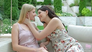 Two beautiful starlets kissing and licking outdoors