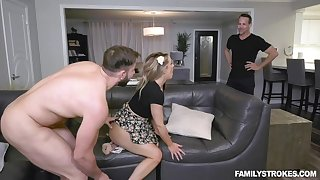 Insatiable babe satisfies two horny studs on leather couch